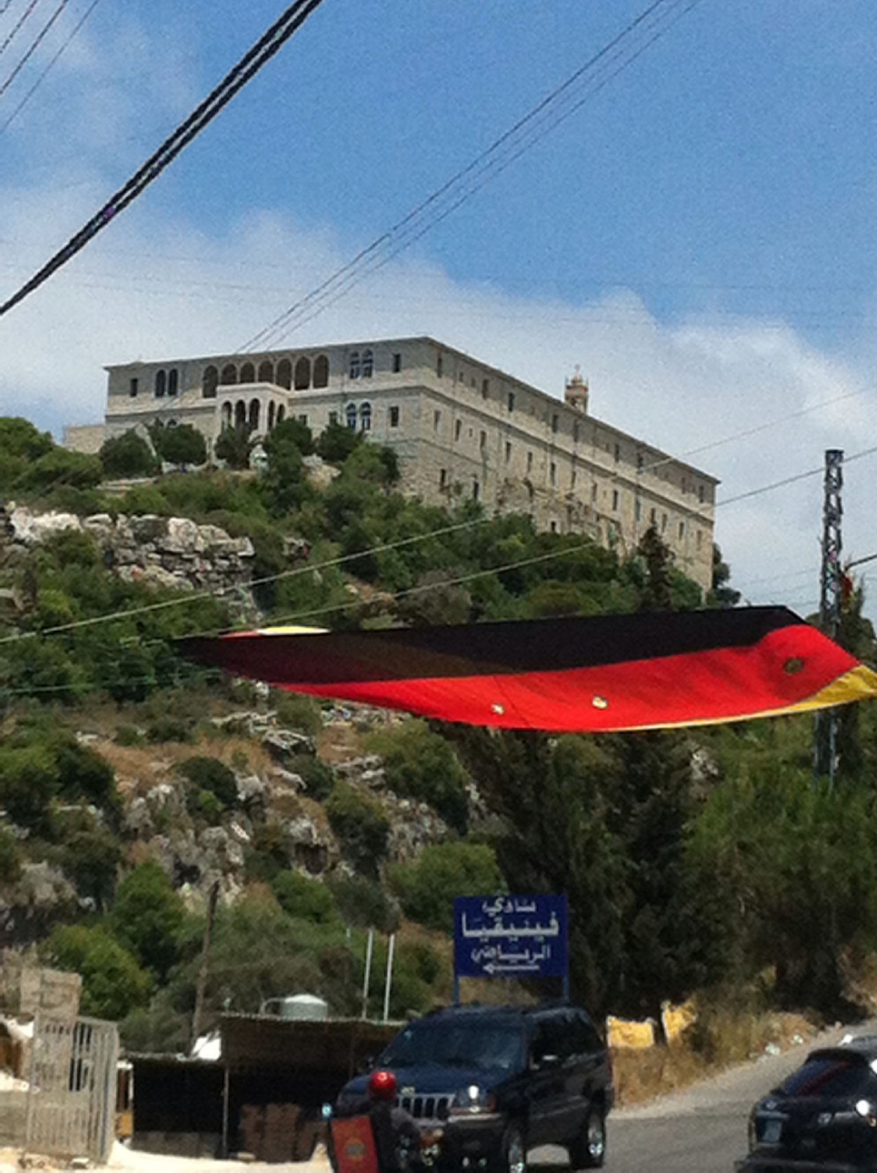 Football Fever In Byblos  Lebanon. The Notre Dame Des Secours Convent Overlooking And Blessing The German Flag