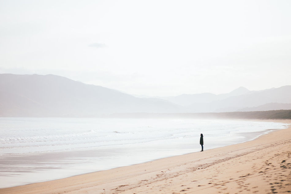 Alone Beach Beauty In Nature Day Long Goodbye Missing Mountain Mountain Range Nature One Person Outdoors People Real People Sand Scenics Sea Shore Sky Standing Tranquil Scene Tranquility Travel Destinations Water TCPM