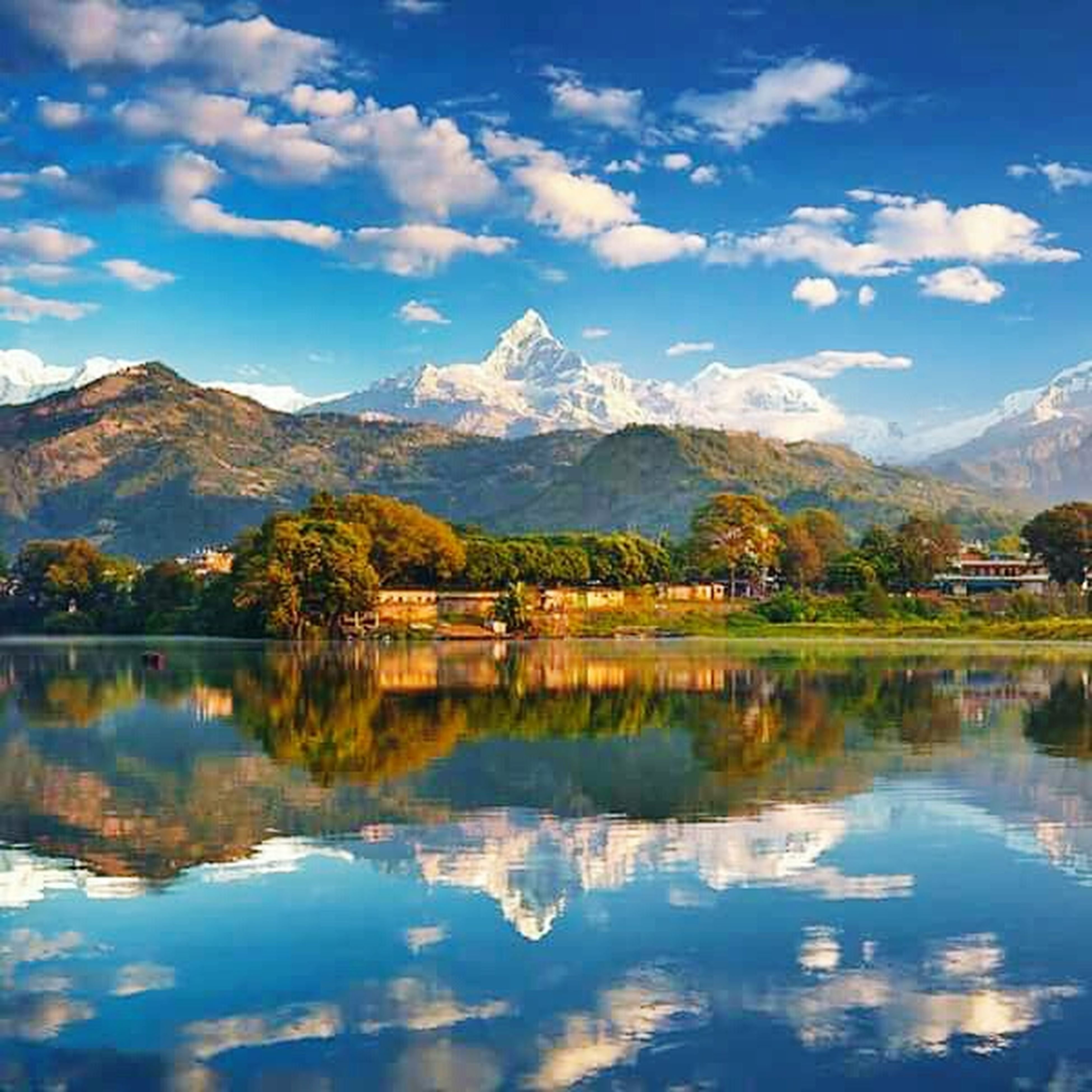 reflection, lake, mountain, tranquil scene, water, tranquility, scenics, beauty in nature, sky, tree, waterfront, mountain range, nature, standing water, cloud - sky, blue, idyllic, cloud, calm, majestic