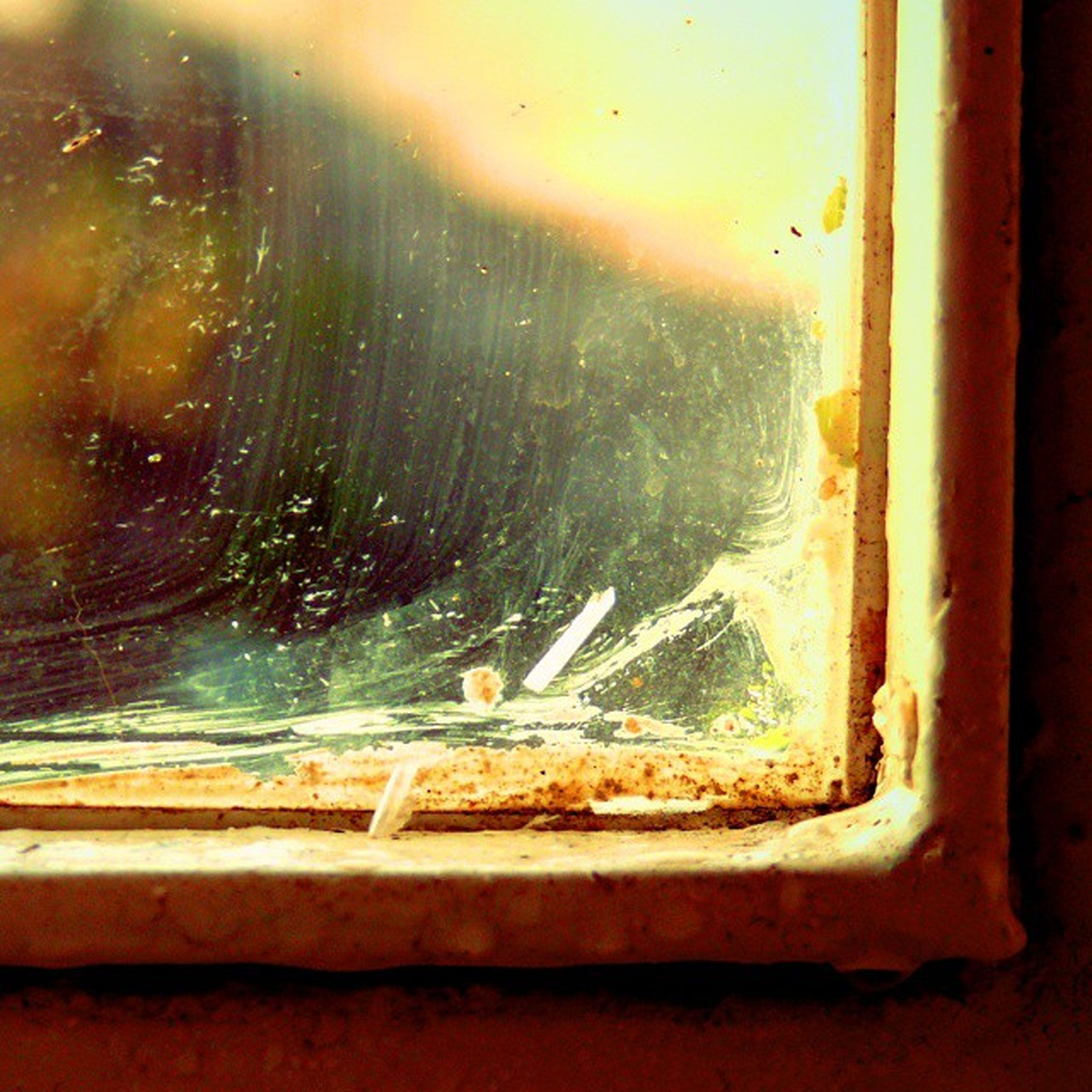 window, indoors, glass - material, transparent, water, close-up, wet, drop, built structure, architecture, no people, day, focus on foreground, sky, damaged, glass, nature, abandoned, rain, sunlight