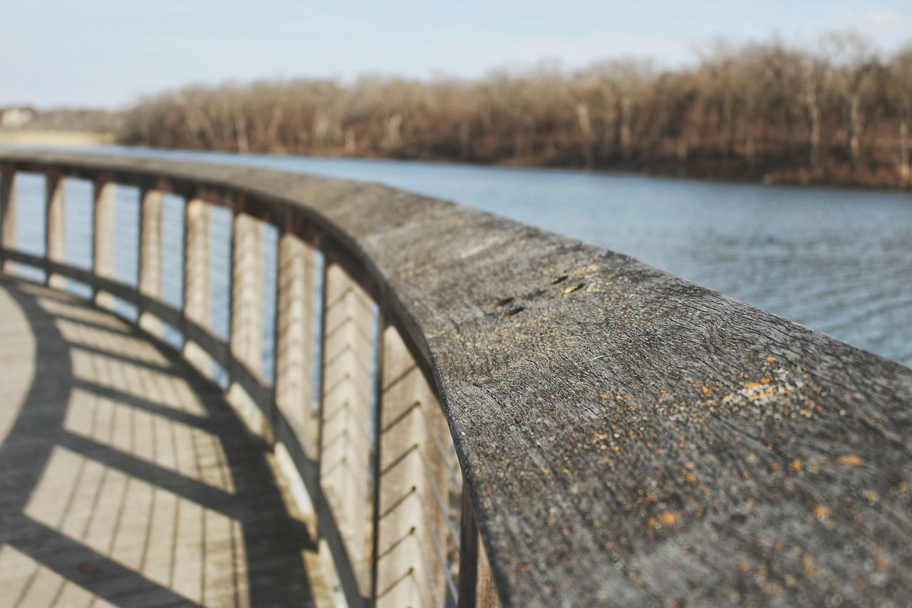 Lake Lake View Lakeside Selective Focus Wood Wood - Material Wooden Railing Railing Macro Macro Photography Canon Eos Rebel SL1 Clear Sky No People Water Tranquility Nature Day Outdoors Bridge - Man Made Structure Tree Sky