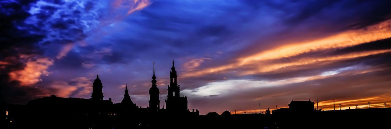 architecture, built structure, cloud - sky, sky, silhouette, building exterior, sunset, low angle view, travel destinations, no people, illuminated, outdoors, nature, city, beauty in nature