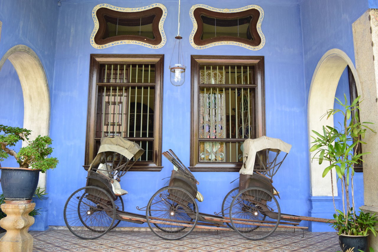 Bicycle Colonial Building Colonial Era Colonial Windows Day Outdoors Penang Island Blue Mansion Rickshaw Rickshaw Against Colonial