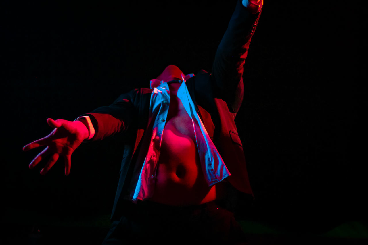 Black Background Dancer Dancing Dark EyeEm Diversity Fall Human Body Part Indoors  Lost Night One Person People Performance Performing Arts Event Resist Stage - Performance Space Stage Costume Stage Light Standing Studio Shot Suit Young Adult