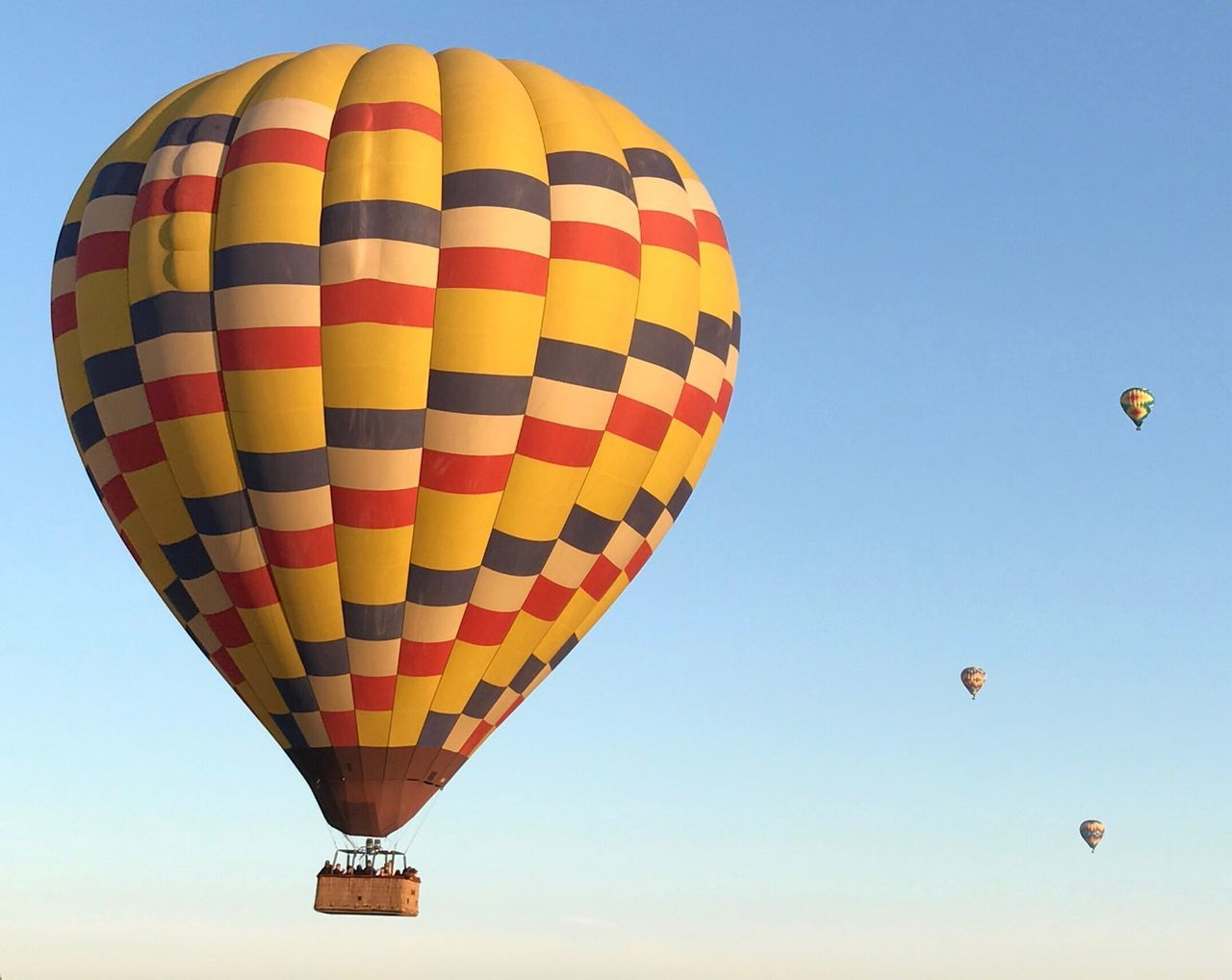 Hot air balloon ride! Clear Sky Transportation Adventure Flying Hot Air Balloon Travel Mid-air Multi Colored Parachute Blue Leisure Activity Recreational Pursuit Air Vehicle Journey Getting Away From It All Yellow Outdoor Pursuit Exploration Vacations