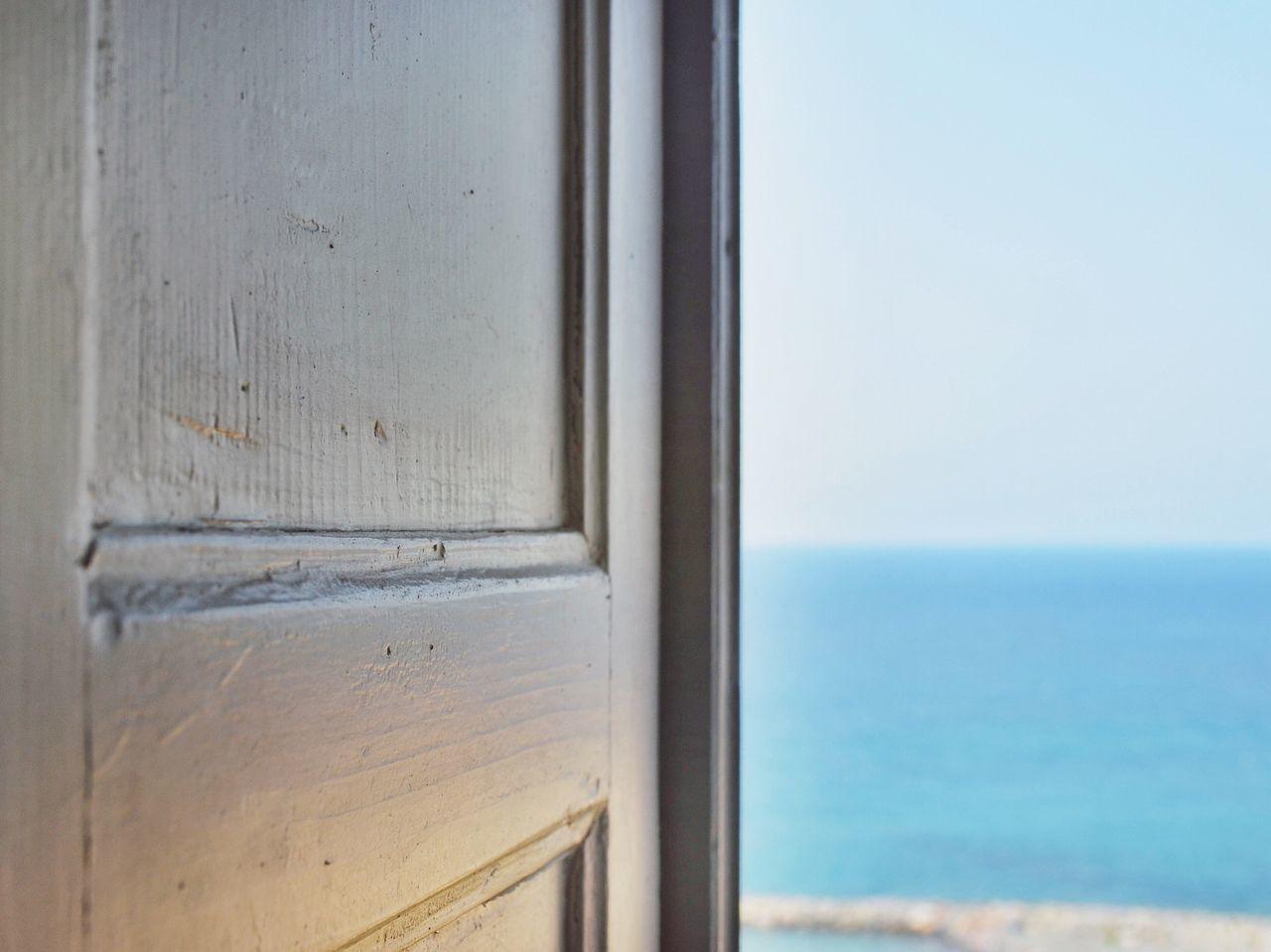 Sea Against Sky Seen Through Open Door