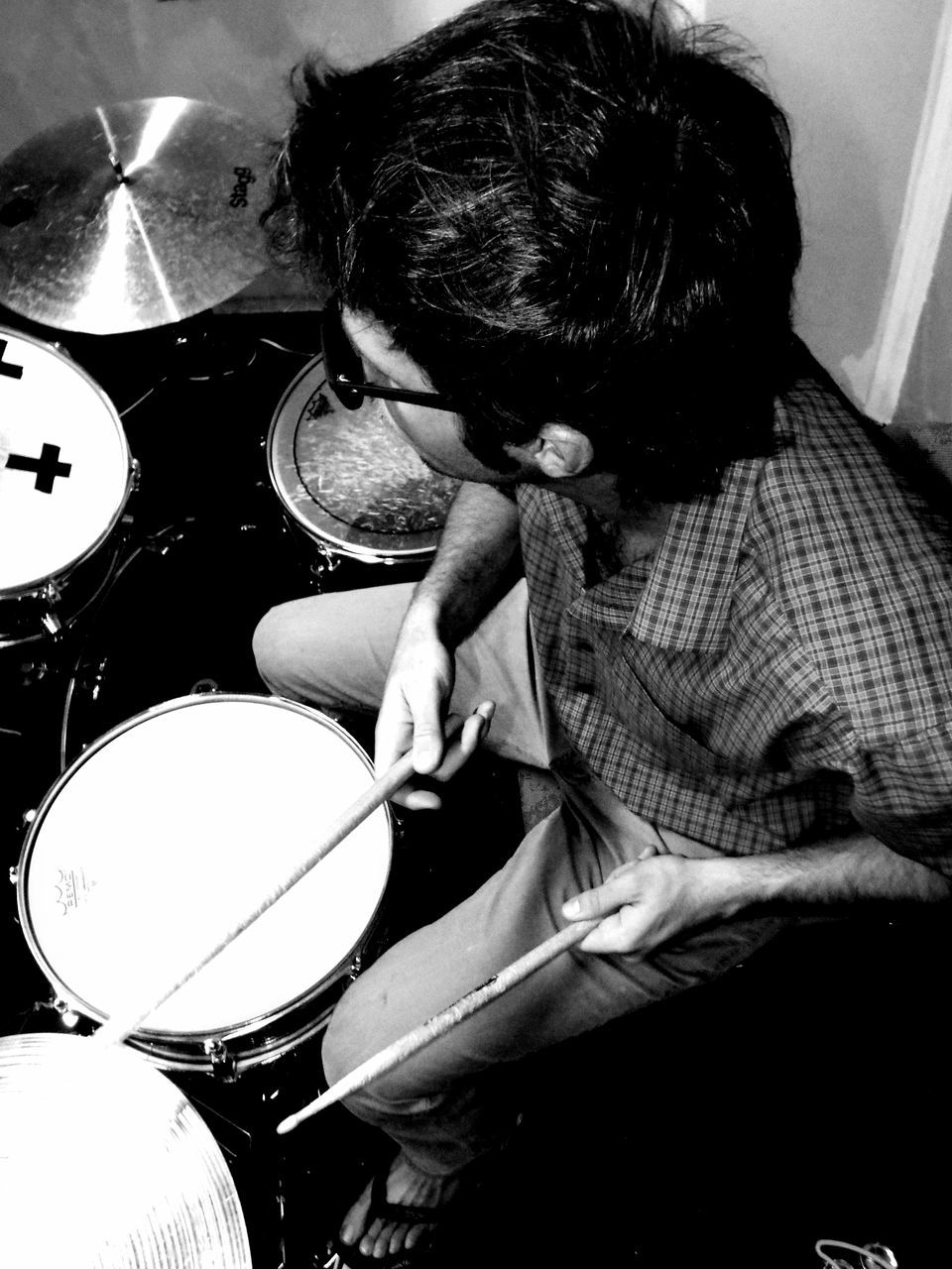 High Angle View Of Man Playing Drum At Home
