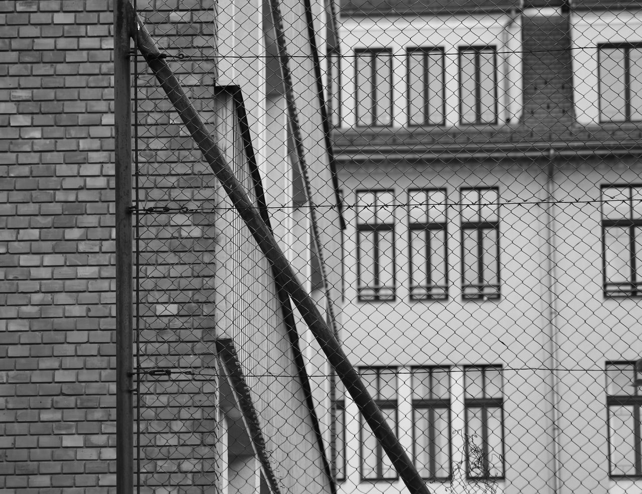 architecture, built structure, building exterior, safety, steps and staircases, staircase, brick wall, fire escape, steps, day, outdoors, no people, full frame, close-up
