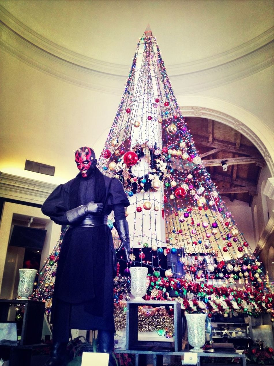 Because nothing says 'Happy Holidays' like a Darth Maul statue in front of a Christmas tree in a sushi restaurant...