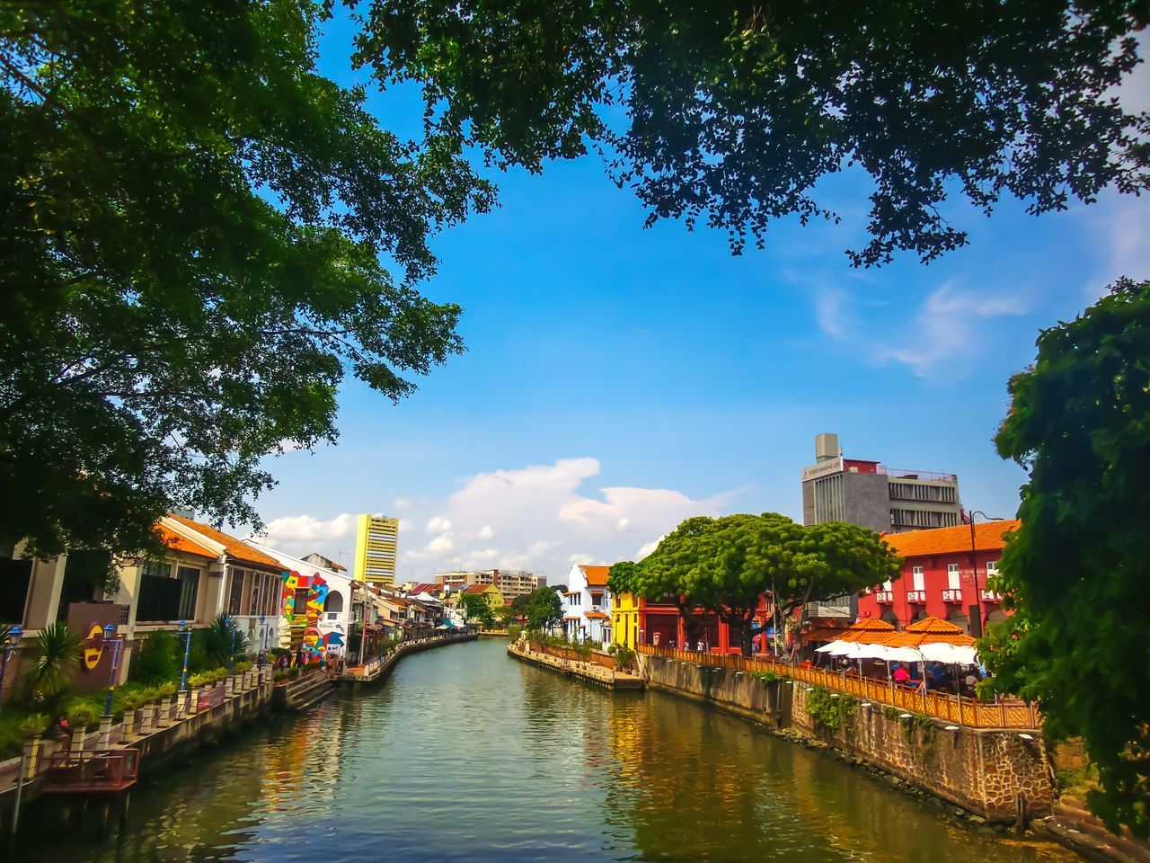River in the town of malacca, Malaysia. ASIA Beautiful Building Malaysia Destination City Town River Street Tree Water Wall Watertown Traditional Bridge Tourism Painting Outdoors Sky Cloud Nature View Landscape House Travel
