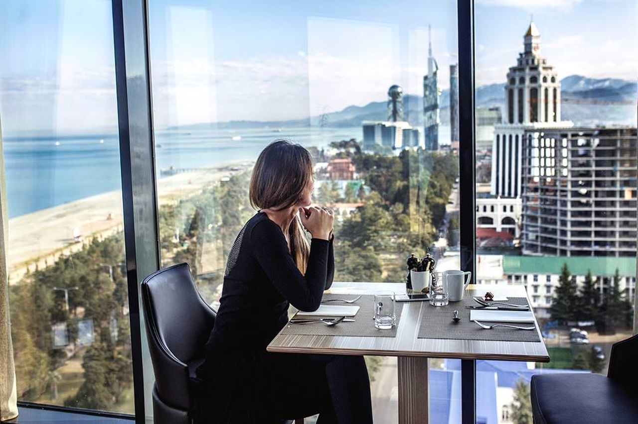 Adult Adults Only Business Business Finance And Industry Businessman Businesswear Businesswoman City City Life Cityscape Corporate Business Desk Indoors  Looking Through Window Luxury Office One Person One Woman Only Only Women People Rear View Reflection Urban Skyline Window Women