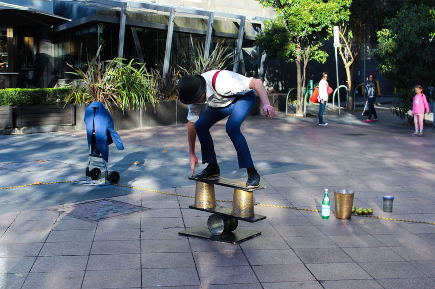 This is a usual day in Melbourne's CBD. A lot of street performers with a lot of skills. Casual Clothing CBD City Life Classy Day Full Length Fun Holding Leisure Activity Lifestyles Melbourne Performer  Person Playing Street Sun Togetherness