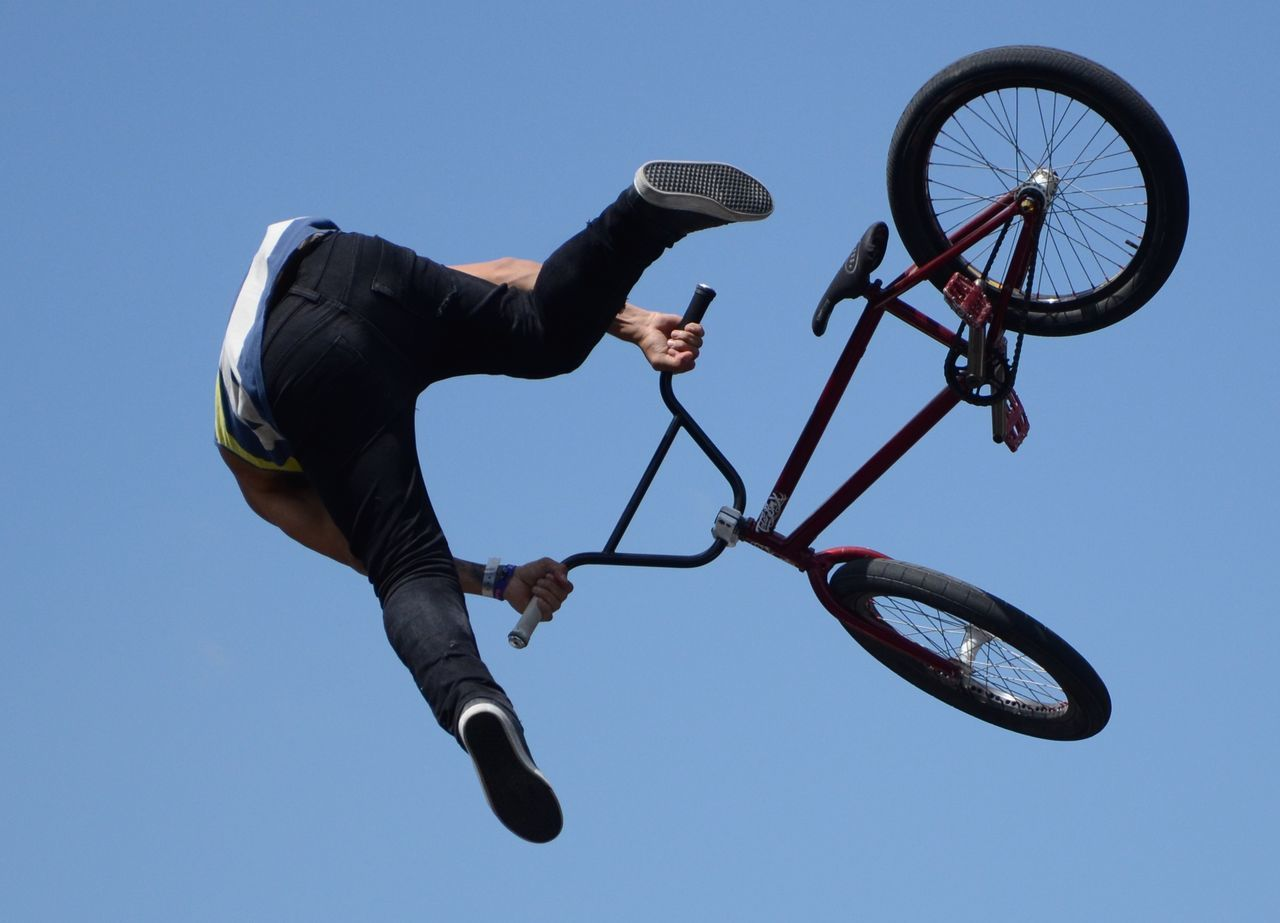 On Your Bike The Moment - 2015 EyeEm Awards Streetphotography Bmx  Sport TwentySomething Capture The Moment Sport In The City Going The Distance Adrenaline Junkie Celebrate Your Ride Photography In Motion Blue Wave Alternative Fitness