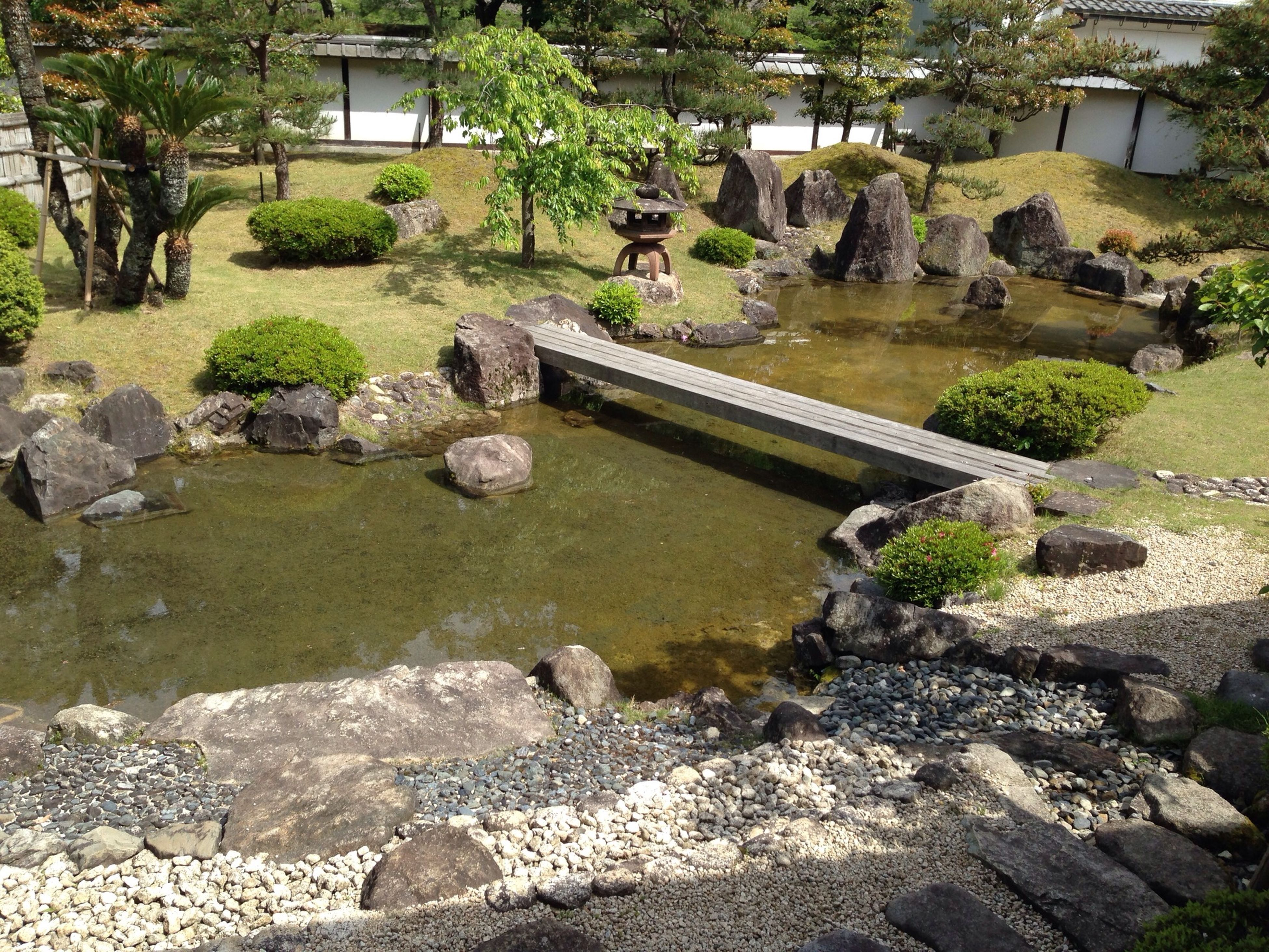water, rock - object, bridge - man made structure, stream, connection, river, stone - object, nature, tree, flowing water, tranquility, built structure, reflection, flowing, arch bridge, tranquil scene, stone, green color, scenics, plant
