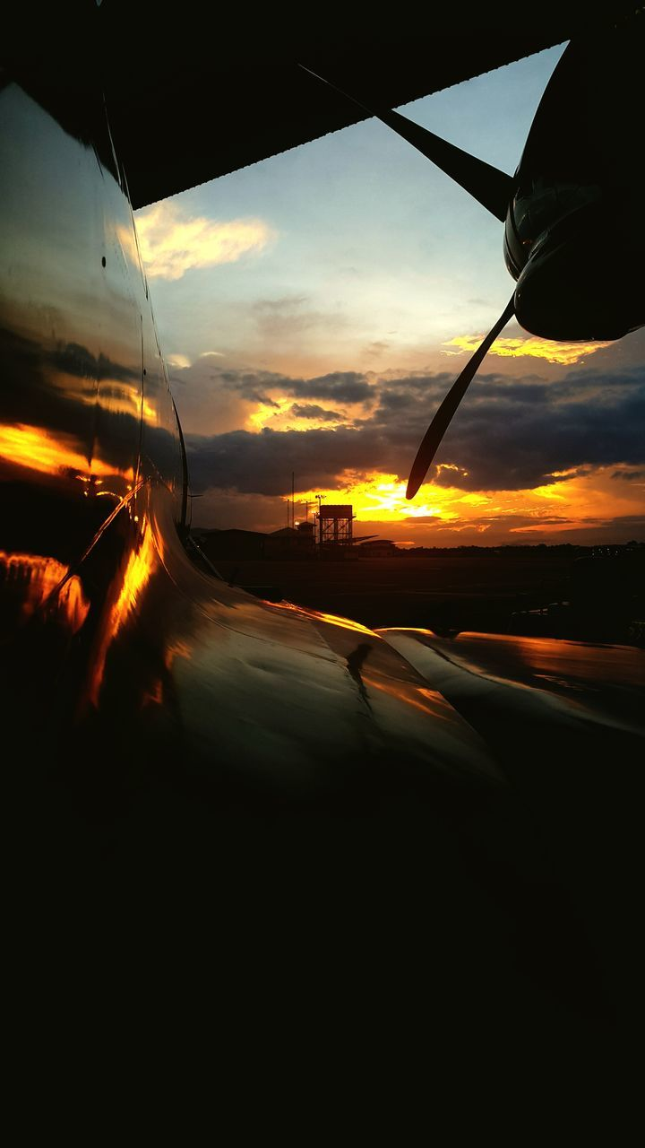 sunset, transportation, mode of transport, sky, car, no people, land vehicle, nature, outdoors, beauty in nature, close-up, day, airplane wing