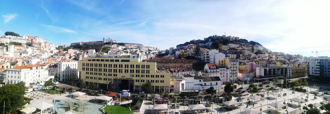 Panoramic view of Martim Moniz in Lisbon, Portugal. City Life City Square Chinatown Chinatown Lisbon Lisboa, Portugal Martim Moniz  Castelo De São Jorge City Cityscape Arts Culture And Entertainment Outdoors Crowd Sky Vacations Day Architecture Skyscraper