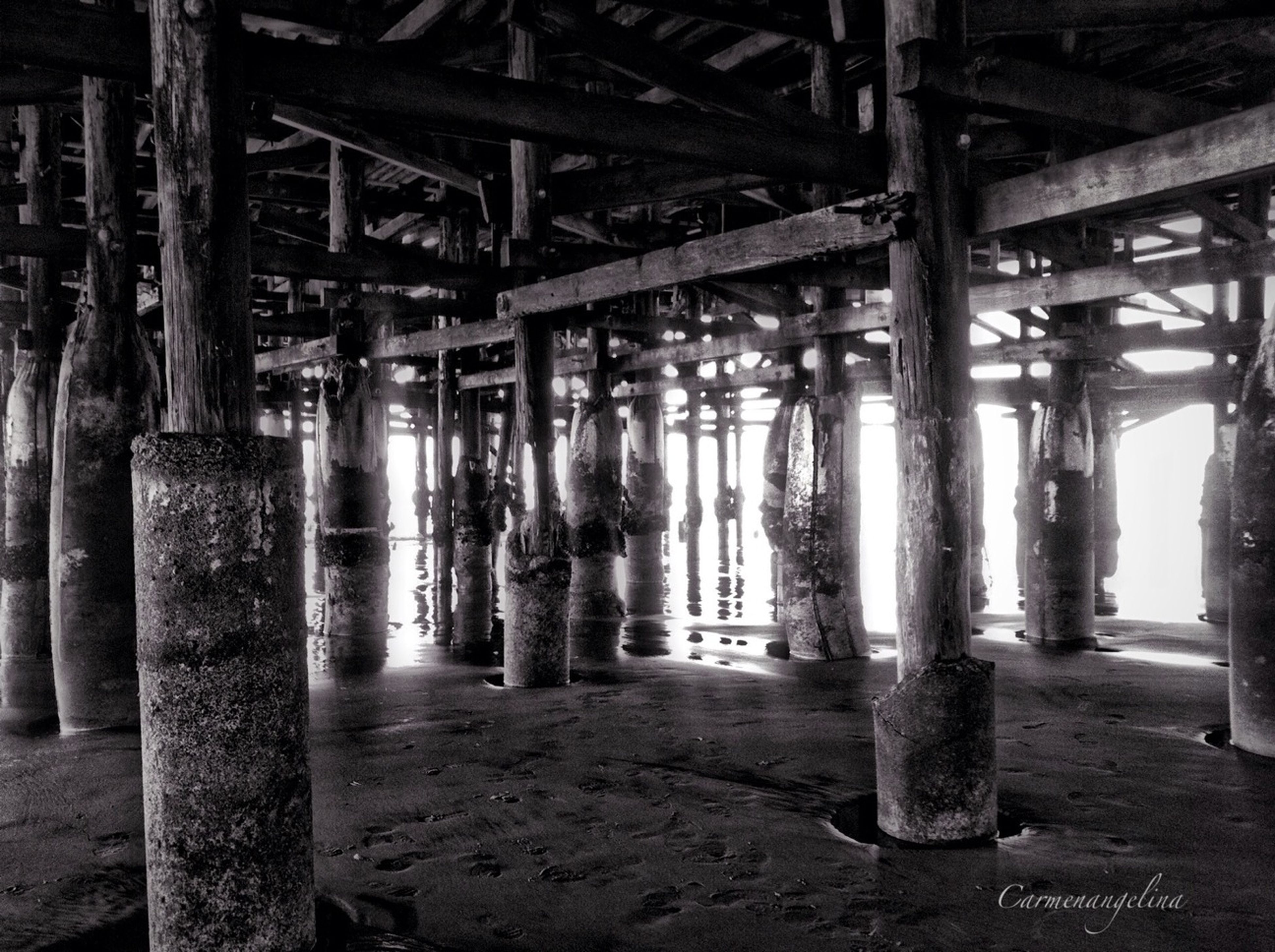 architectural column, built structure, wood - material, architecture, in a row, column, support, abandoned, industry, indoors, below, sunlight, metal, day, wooden, old, no people, bridge - man made structure, connection, obsolete