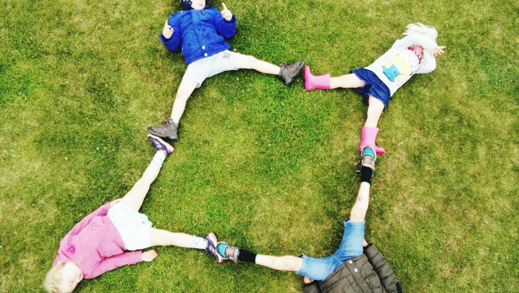 Grass High Angle View Person Casual Clothing Lying On Back Holding Field Lying Down Practicing Person Innocence Day Outdoors Green