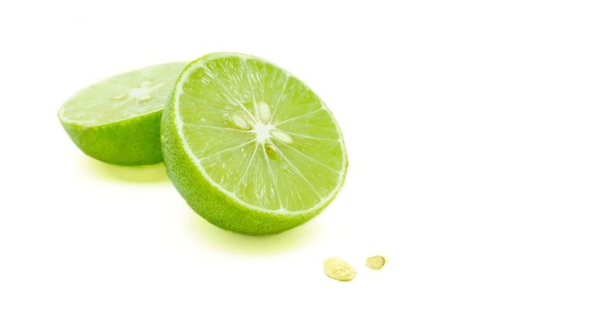 Two halves of a split green lime with seeds, isolated on white background. A kind of fruit used as an ingredient for cooking, especially for sour food. Scientific nane - Citrus x aurantiifolio. Food White Background Green Color Food And Drink Lime Studio Shot Healthy Eating Citrus Fruit Plant Freshness No People Fruit Close-up Nature Nutritional Supplement Sour Taste Cooking Ingredient Sliced Fruit Dieting Citrus X Aurantifolio Seeds Aromatic Plants Herb