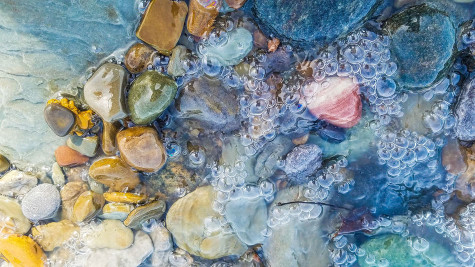 Backgrounds Full Frame Outdoors Multi Colored Textured  No People Close-upDay Pebble Beach Tranquil Scene Beach Beauty In Nature Nature Pebble Water