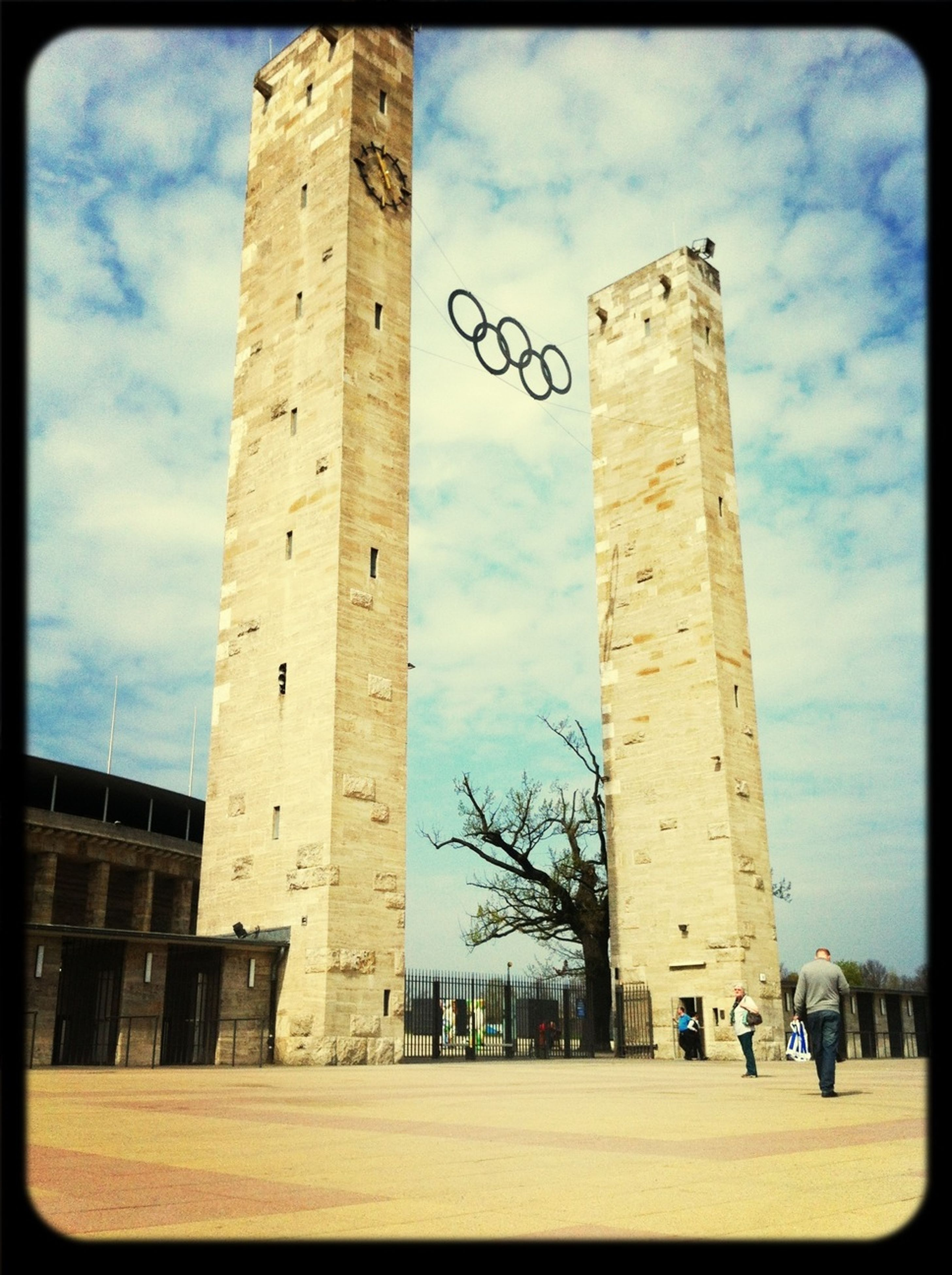 architecture, built structure, building exterior, sky, cloud - sky, low angle view, cloud, history, transfer print, auto post production filter, cloudy, tower, city, day, outdoors, incidental people, shadow, old, column, famous place