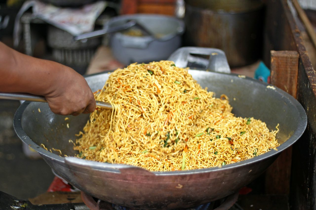 Asian Food Bakmi Goreng Bami Goreng Close-up Day Food Food And Drink Freshness Fried Noodle Fried Noodles Healthy Eating Human Body Part Human Hand Indoors  Market Stall Occupation One Person People Real People Stir Stir Fried Stir Fried Noodle Stir Fry Noodles Street Food Working