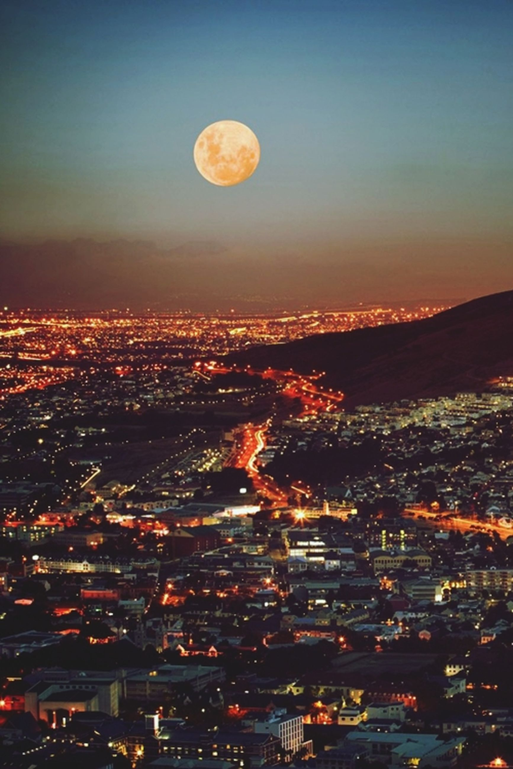 illuminated, cityscape, night, city, building exterior, aerial view, sky, architecture, built structure, moon, clear sky, crowded, scenics, residential district, landscape, dusk, copy space, outdoors, mid-air, high angle view