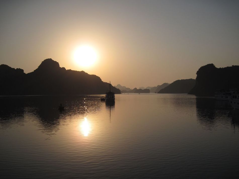 Beautiful sunrise over Halong Bay in Vietnam. Water Sun Silhouette Mountain Nature Scenics Tranquility Tranquil Scene Beauty In Nature Reflection Waterfront Outdoors No People Sky Clear Sky Sea Sunrise Halongbay Halong Bay  Halong Vietnam