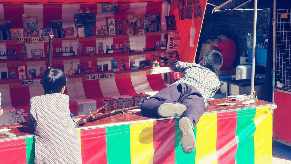 Capture The Moment Shinjuku Tokyo,Japan Traditional Local Festival Kids Shooting Games