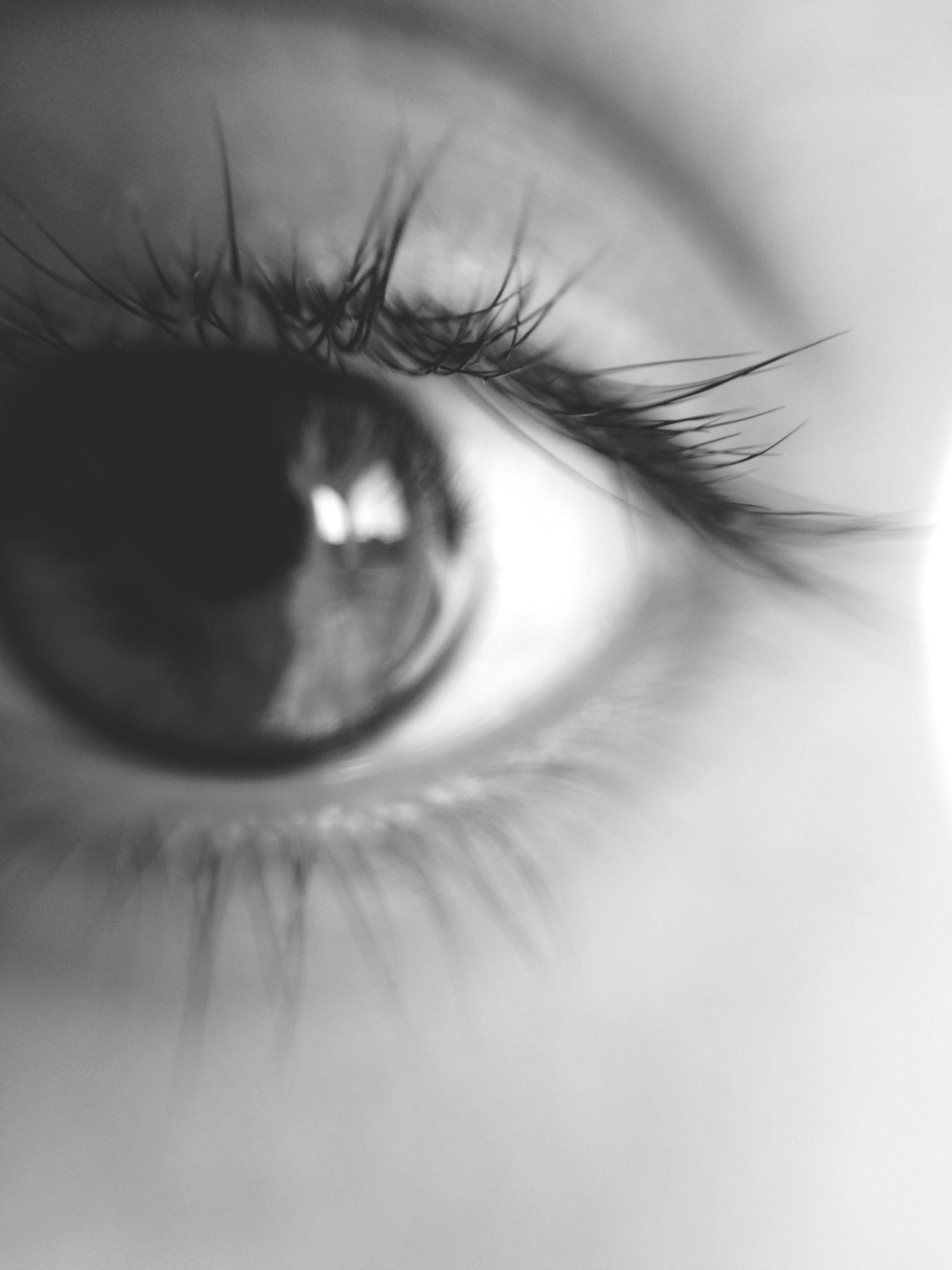 close-up, human eye, eyelash, part of, extreme close-up, eyesight, human skin, sensory perception, extreme close up, eyeball, cropped, person, iris - eye, indoors, selective focus, studio shot, detail