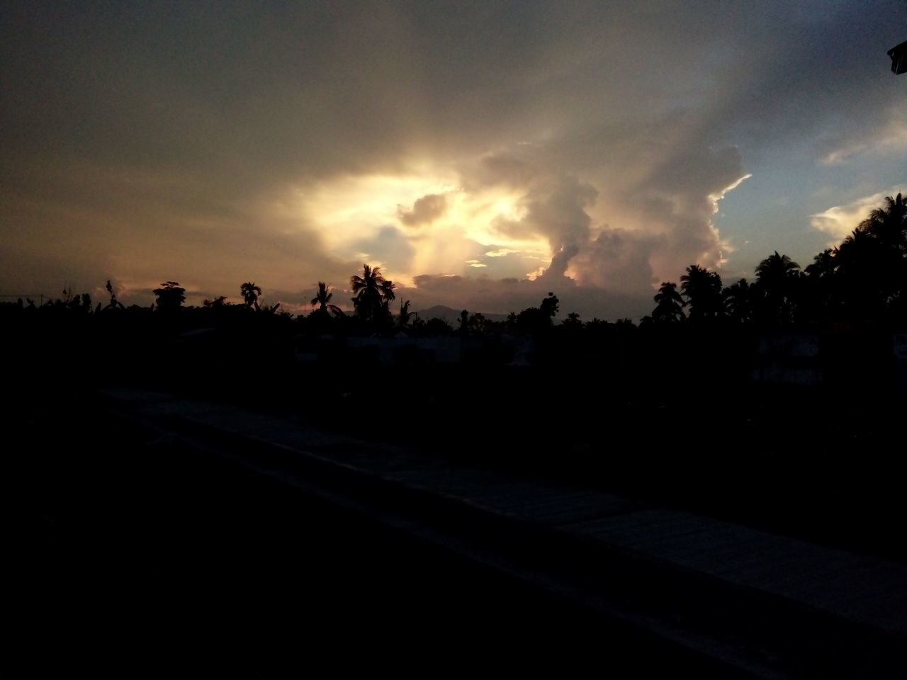 sunset, silhouette, sky, cloud - sky, tree, dramatic sky, scenics, nature, no people, transportation, tranquility, tranquil scene, landscape, outdoors, beauty in nature, storm cloud, day