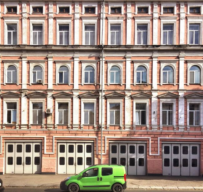 Architecture Built Structure Building Exterior Transportation Car Mode Of Transport Windows Street Parking City Road Building Parked In Front Of Day Outdoors Minivan Green Streetphotography Street Photography Kiev Kiev Ukraine Kievblog Kiev_ig TakeoverContrast