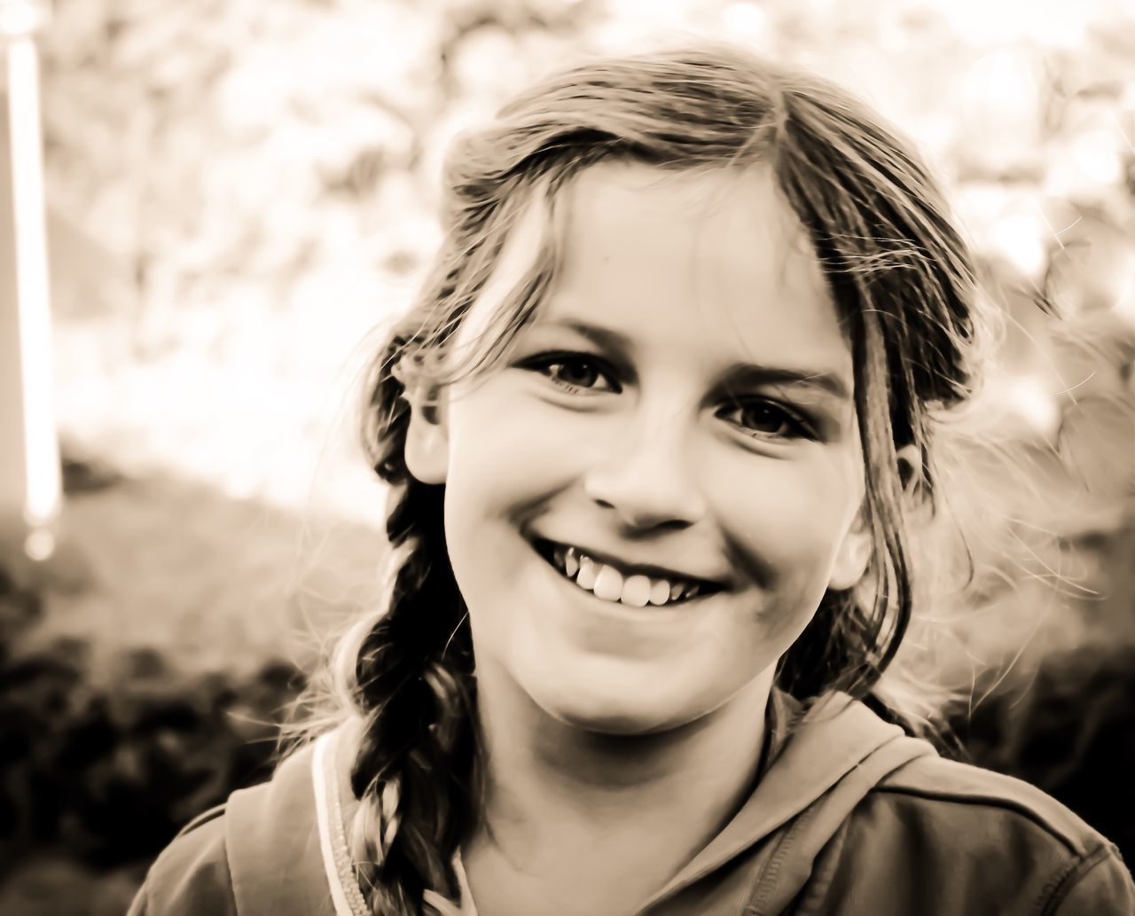 childhood, smiling, portrait, looking at camera, happiness, close-up, innocence, child, focus on foreground, headshot, children only, one person, real people, cheerful, outdoors, day, people