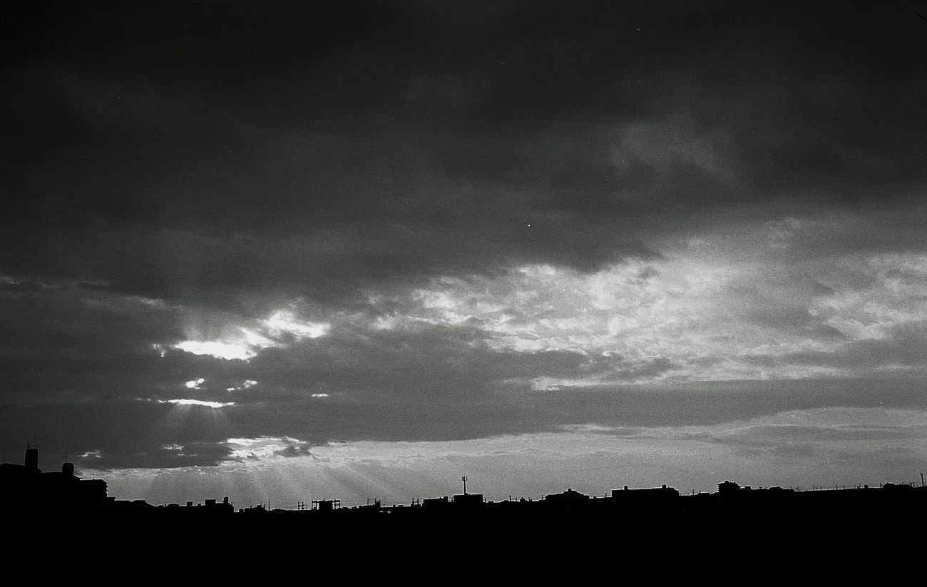 Sky Silhouette Cloud - Sky Beauty In Nature Sunlight Sun Street Snapshots Of Life Filmcamera Black And White Blackandwhite Photography Black And White Photography Film Photography Leica Black And White Bnw Day Monochrome Black & White Film Life Snap