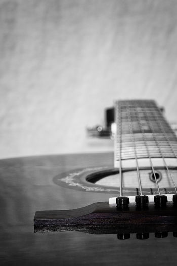 Music brings people together, so grab your guitar and let us rock, a golden moment - 43 Golden Moments Arts Culture And Entertainment Black Color Blackandwhite Close-up Cutaway Exceptional Photographs EyeEm Masterclass Fine Art Photography Home Is Where The Art Is Fretboard Guitar Guitar Body Guitar Strings Illuminated Instruments Modern Music Musical Instruments No People People Together Selective Focus Music Brings Us Together Sound Hole String Instrument