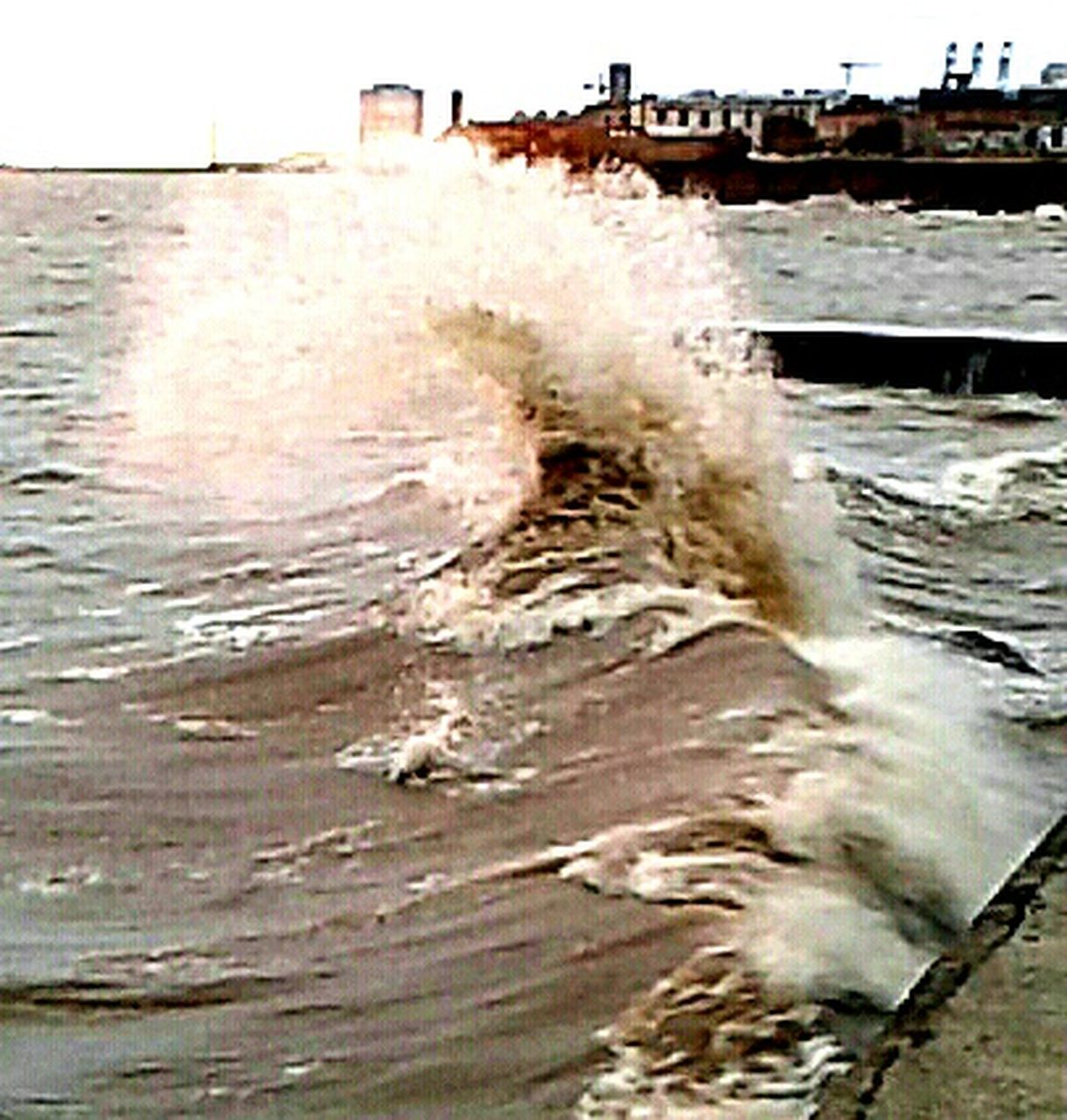 water, motion, sea, outdoors, power in nature, destruction, day, wave, no people, built structure, building exterior, architecture, nature, crash, force, city, sky, close-up