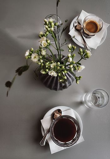 EyeEm Selects Coffee - Drink Coffee Cup Cup Drink Food And Drink Directly Above Flower Vase Indoors  No People Beverage High Angle View Espresso