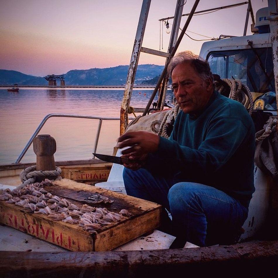 A Fisherman cutting small octopus as a bait for nightly fishing. Kimi port, Greece. VSCO Vscocam Vscogreece Igersgreece Grupamobilni Mobilnytydzien7