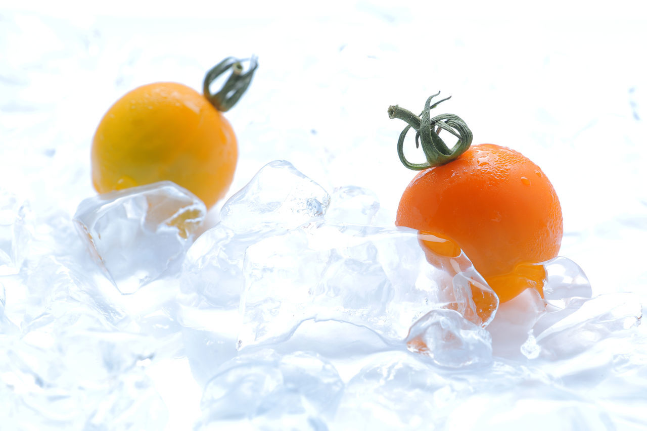 Close-Up Of Cherry Tomatoes On Ice