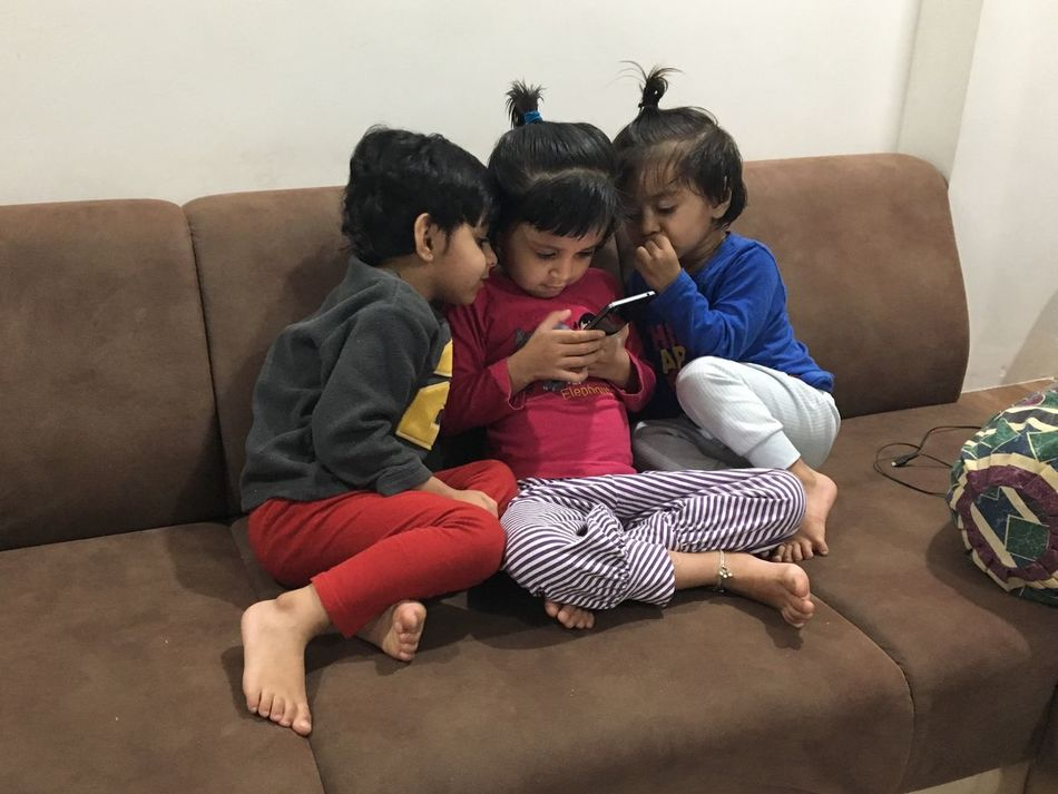 Mobile Conversations Kids Mobile Involved Three Girls Sofa Indoors  Girls Sitting Togetherness Childhood