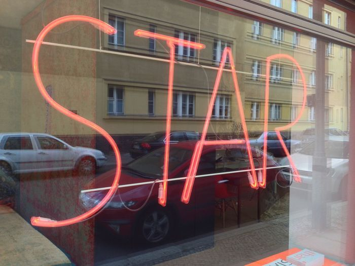 Star Neon Sign Neon Light Behind Window Reflection
