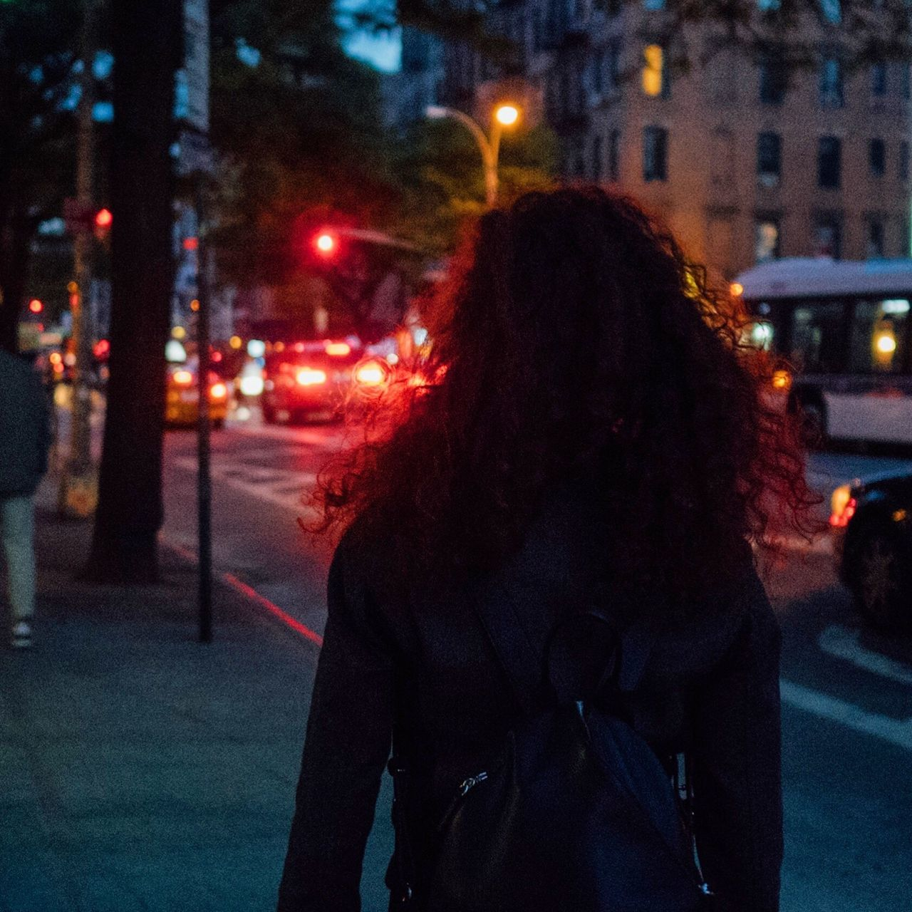 """""""Do not go gentle into that good night. Rage, rage against the dying of the light."""" - Dylan Thomas 1914 - 1953 Night Building Exterior Rear View Street Real People Illuminated Built Structure One Person Architecture City Outdoors Lifestyles City Life Women Long Hair Focus On Foreground Leisure Activity Road Young Adult Warm Clothing BYOPaper! The Street Photographer - 2017 EyeEm Awards"""