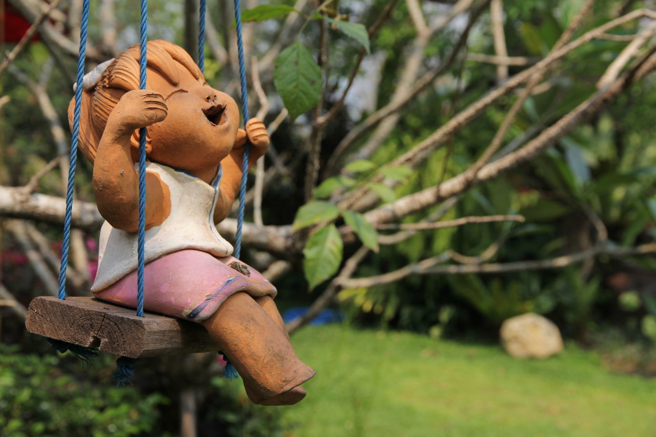 Art And Craft Baked Clay Carousel Childhood Close-up Day Focus On Foreground Human Representation Nature No People Outdoors Sculpture Tree