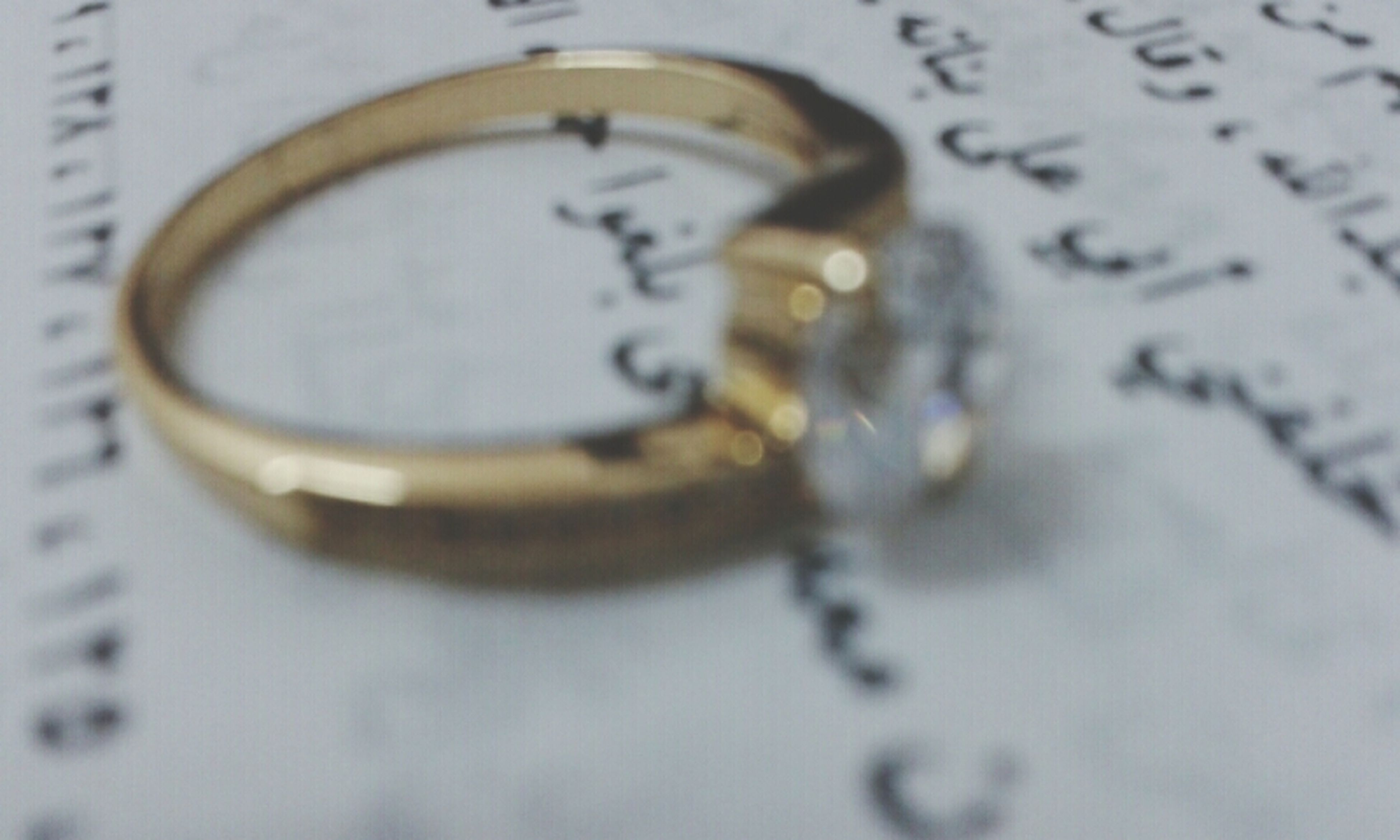 indoors, close-up, text, selective focus, communication, western script, number, still life, focus on foreground, table, single object, no people, high angle view, finance, wealth, time, part of, metal, full frame, circle