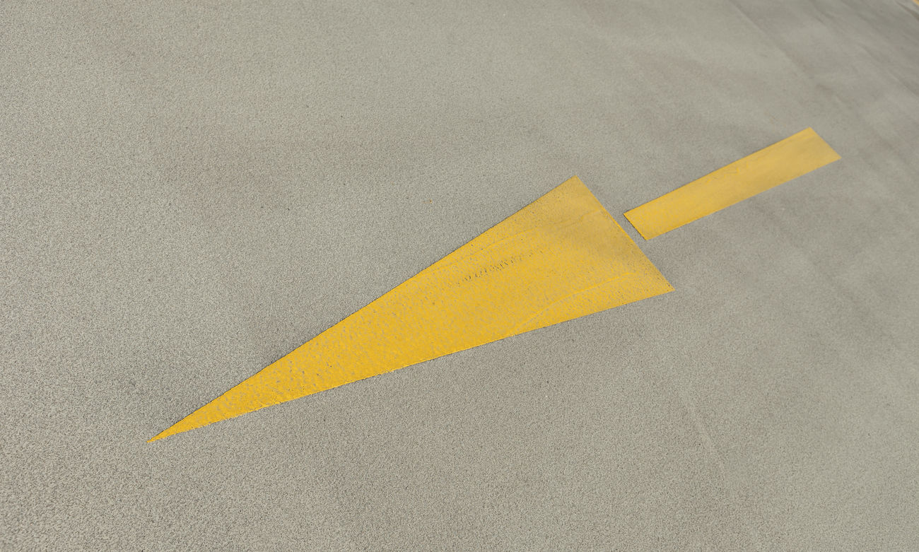 direction Arrow Arrow Symbol Concrete Direction Directly Above Finance High Angle View Money No People Outdoors Paths Street Yellow