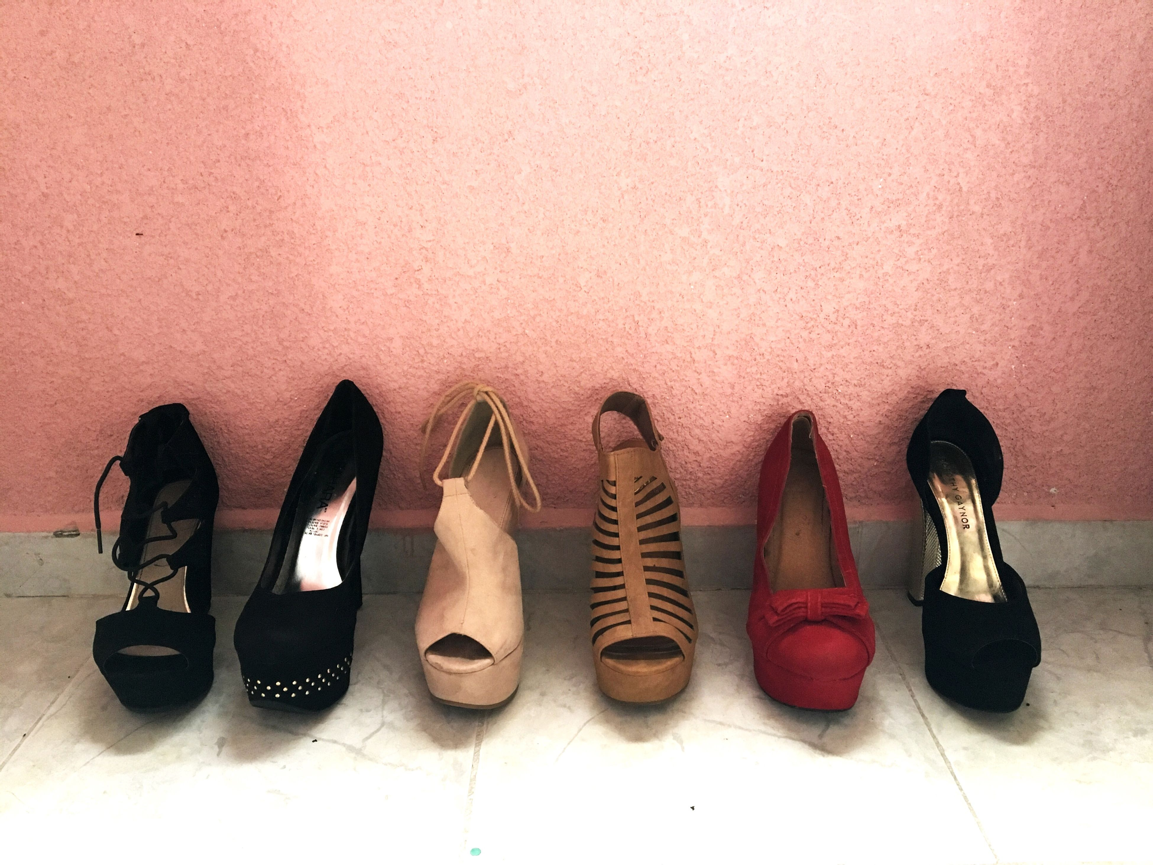 shoe, variation, choice, in a row, colored background, family, modern, black color, fashion, high heels, business finance and industry, pair, indoors, shiny, close-up, people