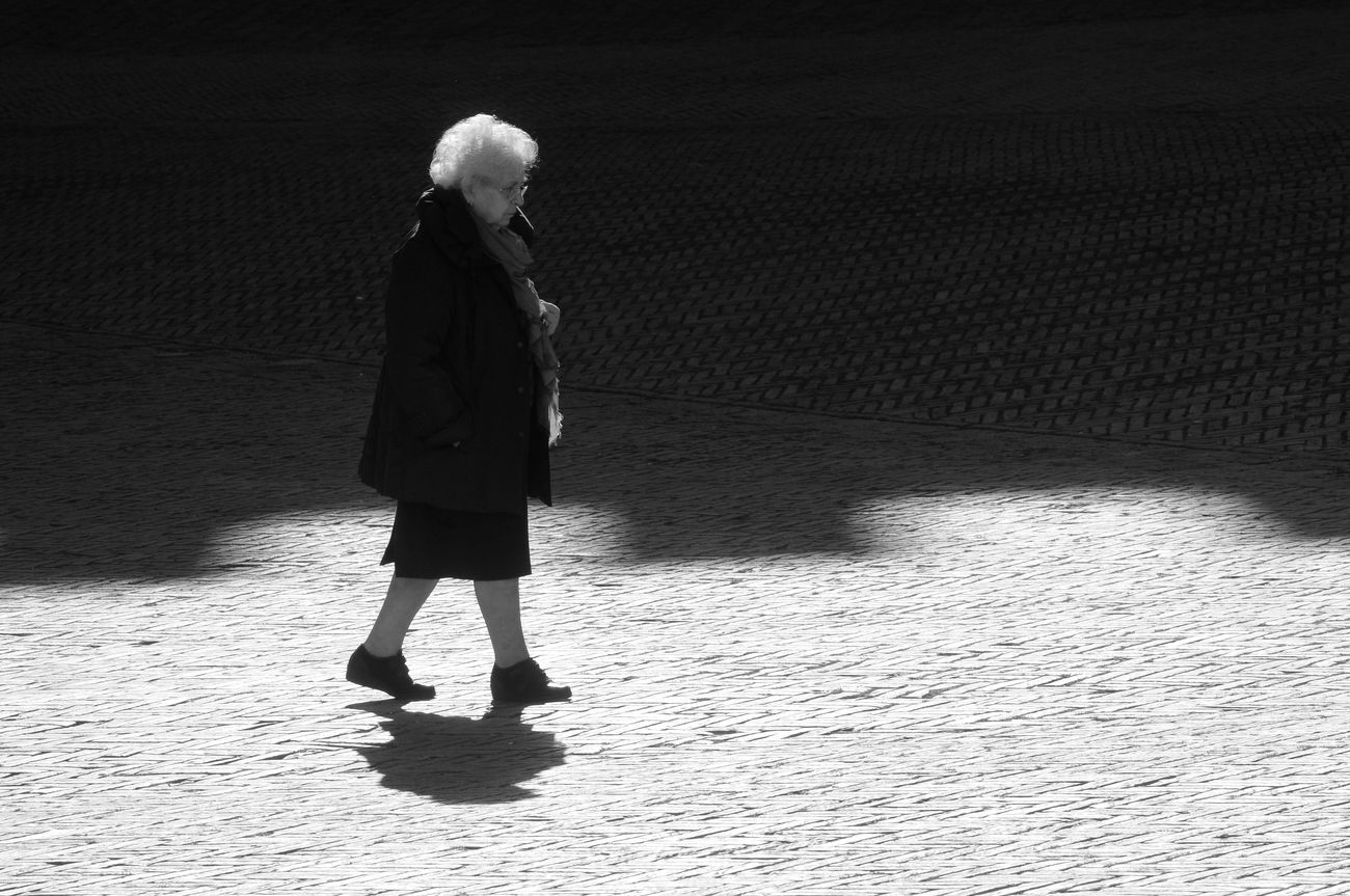 "From the series ""Lights and shadows in the Piazza"" Alone Blackandwhite Contrast Elder Elderlypeople Old Piazza Del Campo Real People Shadow Siena Walking Woman"