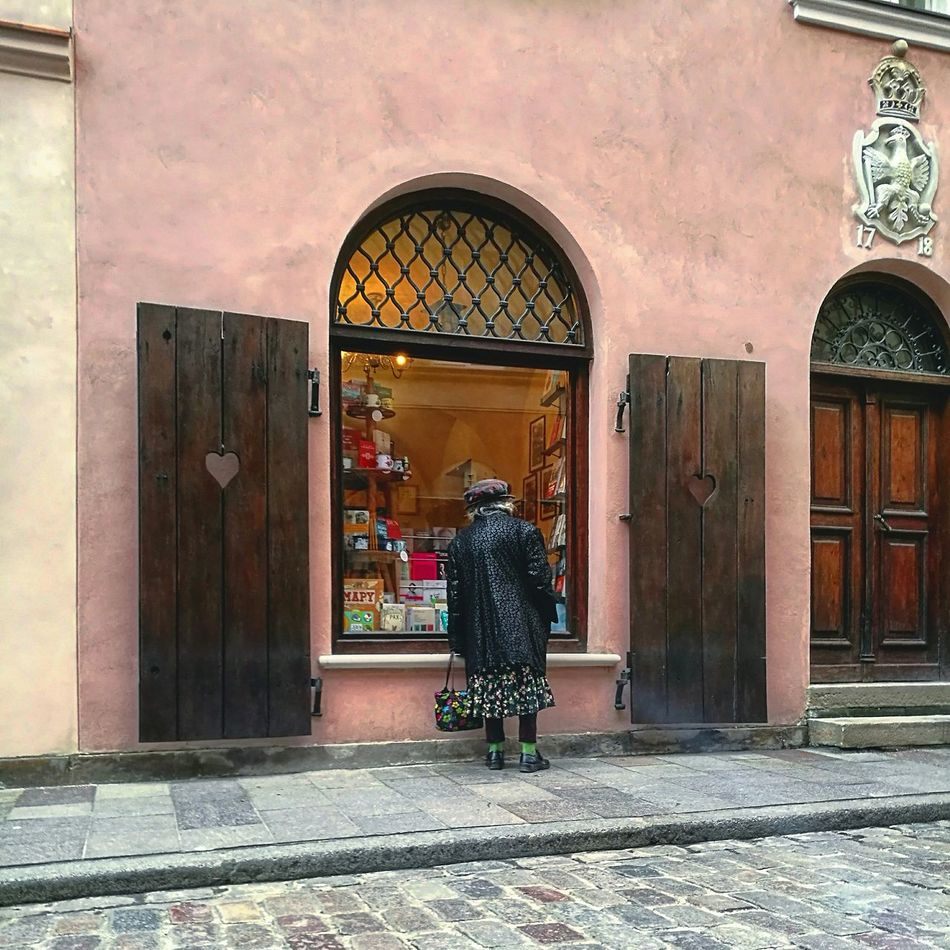 Architecture Built Structure Outdoors One Woman Only Women Day Street Life Streetphotography Oldwoman Green Socks Warsaw Poland Window Shopping Window Arch