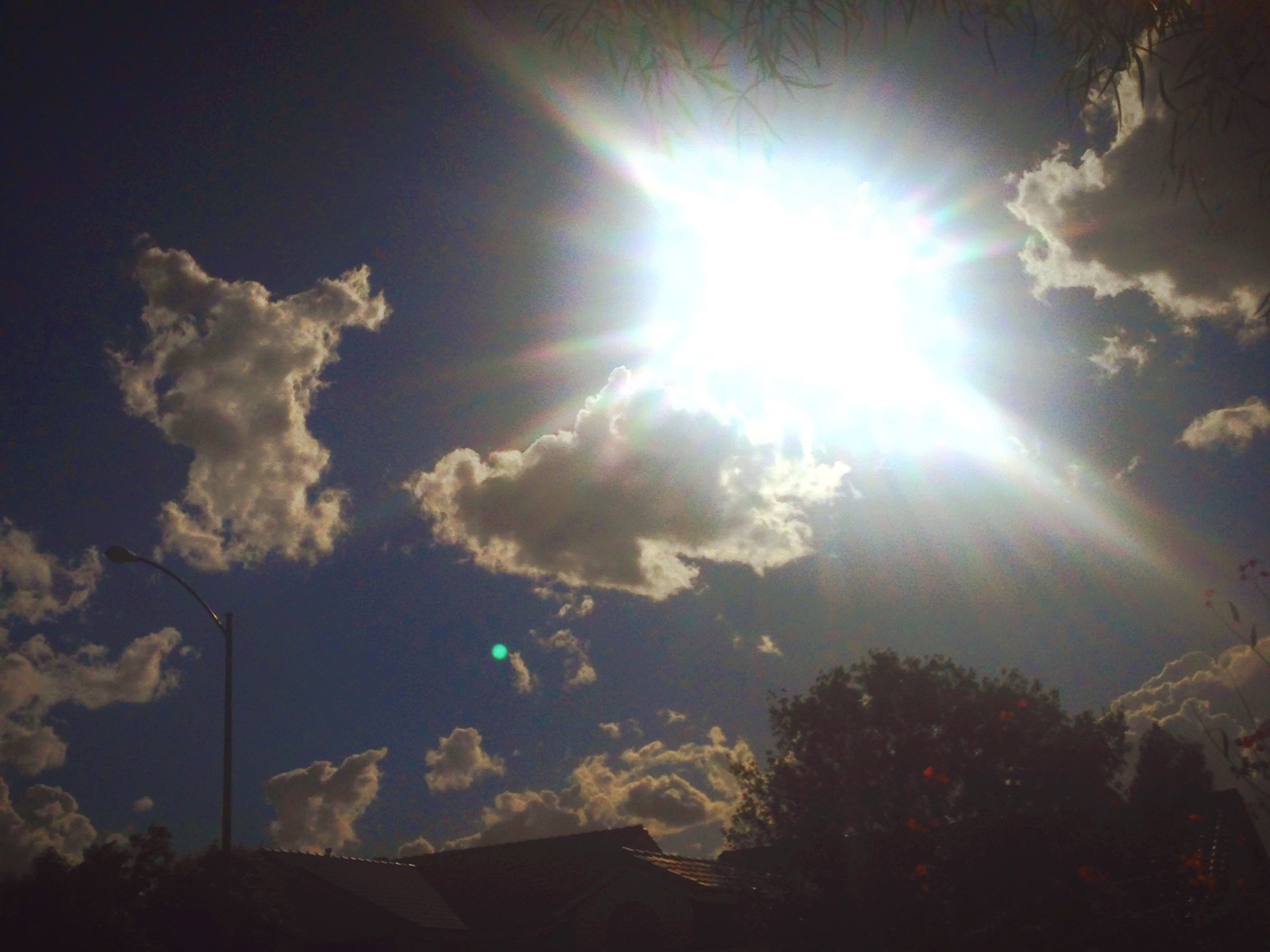 sun, sunbeam, sunlight, lens flare, sky, low angle view, cloud - sky, bright, sunny, beauty in nature, nature, tranquility, blue, scenics, cloud, silhouette, tranquil scene, day, outdoors, no people