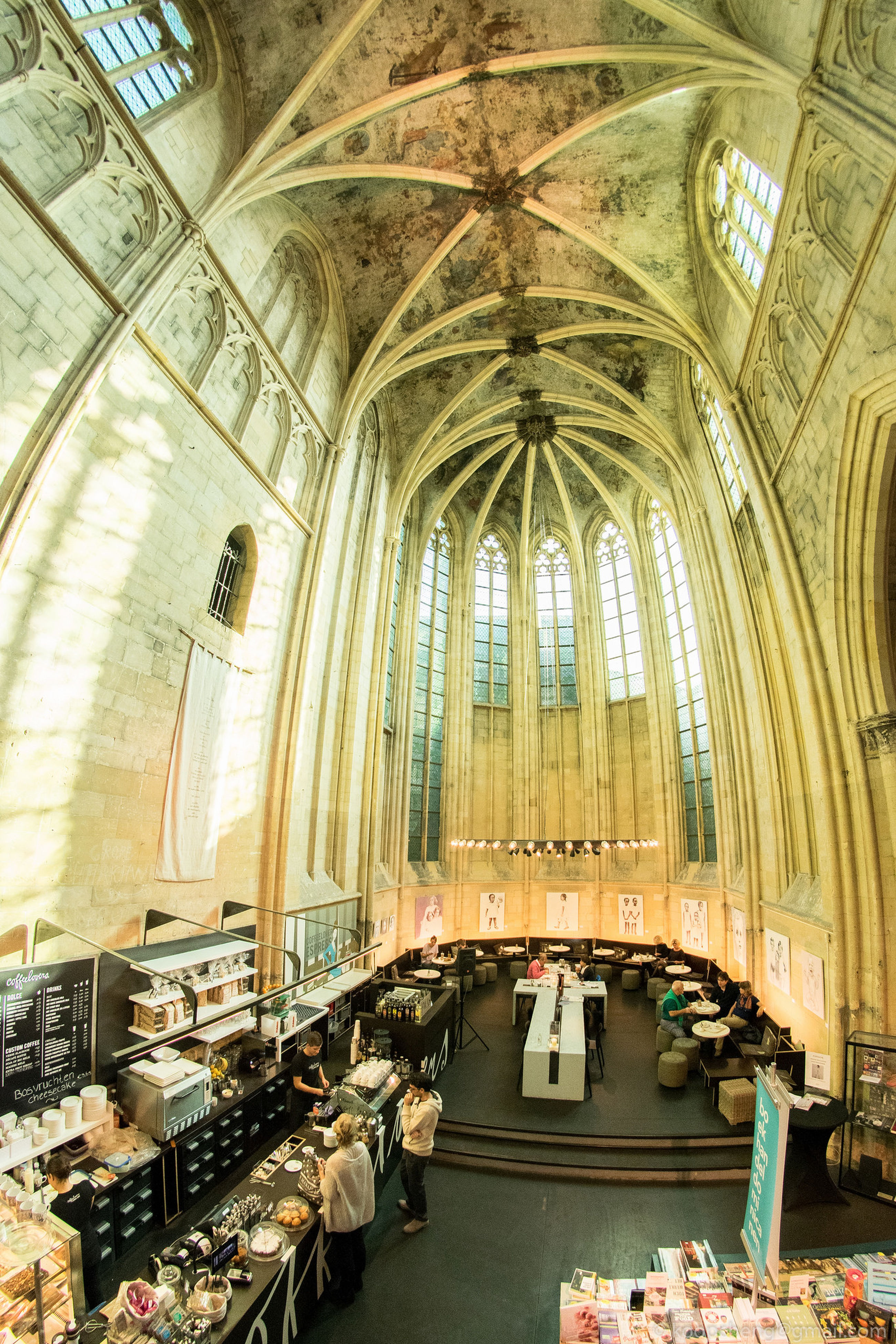 indoors, architecture, built structure, arch, ceiling, interior, transportation, public transportation, place of worship, railroad station, rail transportation, travel, incidental people, church, window, day, building exterior, religion, spirituality